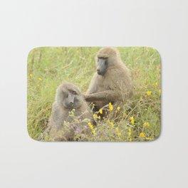 Grooming baboons Bath Mat