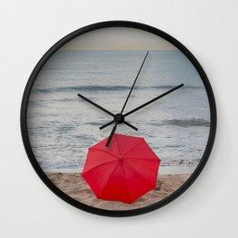 Red Umbrella lying at the beach III Wall Clock
