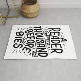 A reader lives a thousand lives before he dies - bookaholic quotes handwritting typography Rug