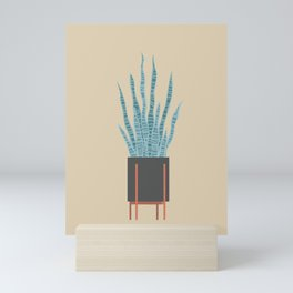 Snake plant in a legged planter Mini Art Print