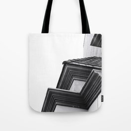 buildings in the city in black and white Tote Bag