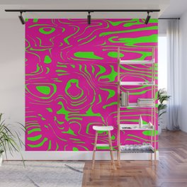 Pink spreading spots of color on green. Wall Mural
