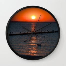 Holy sunset on the Baltic Sea Wall Clock