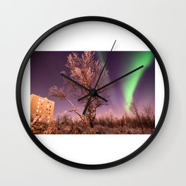 Green northern lights with tree in the middle over the Kiruna town in Sweden. Wall Clock