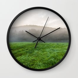 Morning mist over the fields Wall Clock