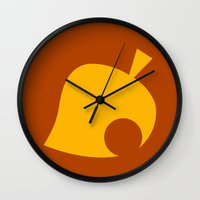 animal crossing Wall Clocks featuring Animal Crossing Autumn Leaf by Rebekhaart