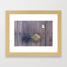 Old door knob with keyholes Framed Art Print