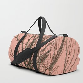 Bare tree against a pink wall Duffle Bag