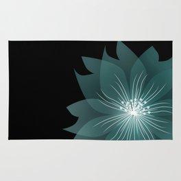 Blue flower on a black background . Rug
