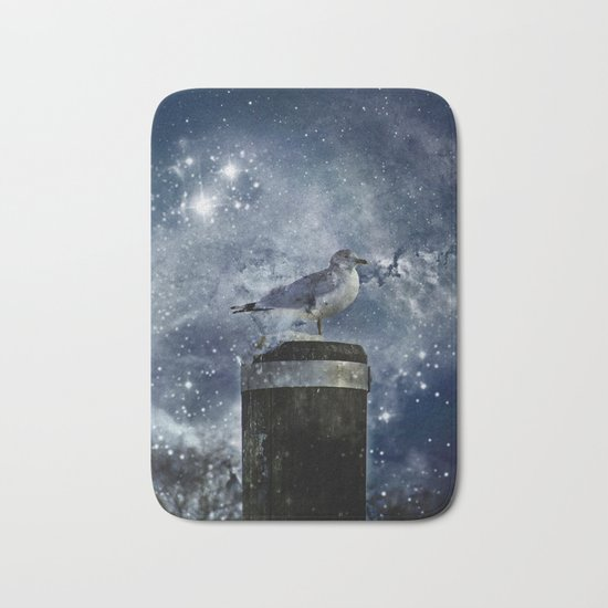 One Legged Seagull in a Snowstorm with Stars in His Eyes Bath Mat