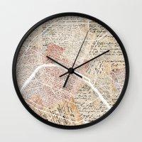 paris map Wall Clocks featuring Paris map by Mapsland