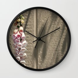 foxgloves against a garden shed Wall Clock
