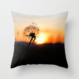 Dandelion blowing in the breeze at Sunset Throw Pillow