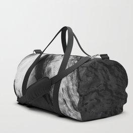 Logs in a Stream Duffle Bag