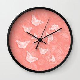 A flutter of butterflies on peach mandala patterns Wall Clock