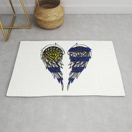 Uruguay wings art Rug
