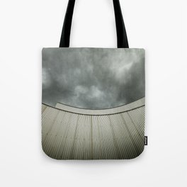 Building with metal covering against stormy sky Tote Bag