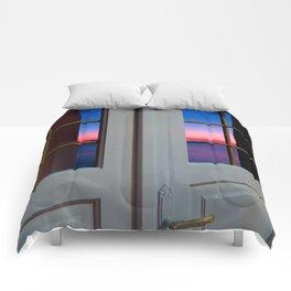 Sunset through the door Comforters