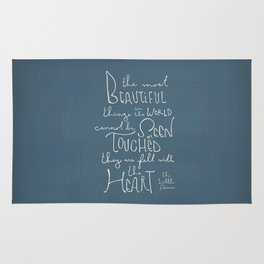 """The Little Prince quote """"the most beautiful things"""" Rug"""