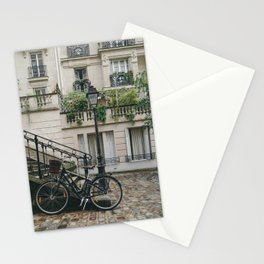 BIKE LEANING AGAINST HANDRAIL IN FRONT OF CONCRETE BUILDING AT DAYTIME Stationery Cards