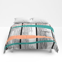Colored arrows on wood Comforters