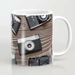 Collection of retro photo cameras on  wood Coffee Mug