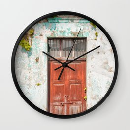 Old red door in Antigua, Guatemala Wall Clock