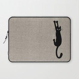 Black Cat Hanging On Laptop Sleeve