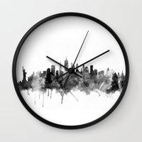 new york skyline Wall Clocks featuring New York City Skyline by artPause