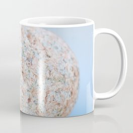 Granite pebble with blue water background Coffee Mug