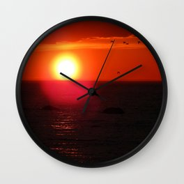 Flying into the Sun Wall Clock