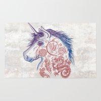 tatoo Area & Throw Rugs featuring War Unicorn by Rachel Caldwell
