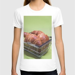 Macro shoot of croissants in shopping basket over green mint background T-shirt