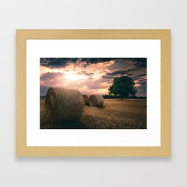 Hay Bales during a lovely sunet in Germany Framed Art Print