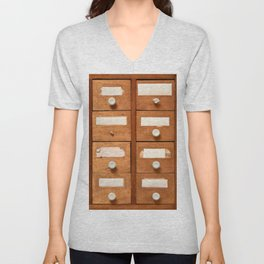 Backgrounds and textures: very old wooden cabinet with drawers Unisex V-Neck