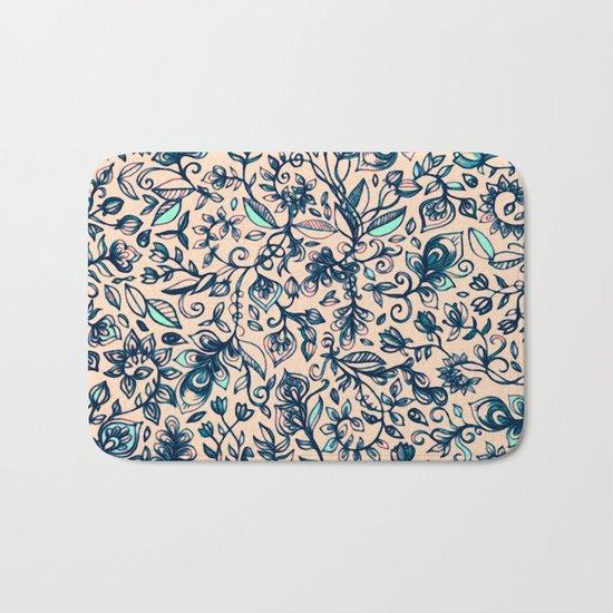 Teal Garden - floral doodle pattern in cream & navy blue Bath Mat