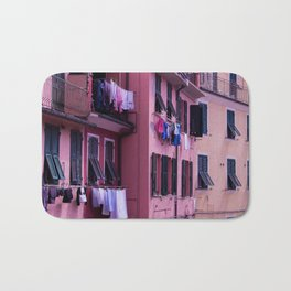 Tuscan building with its typical windows and balconies with clothes drying in the sun Bath Mat