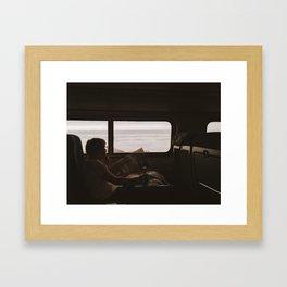WOMAN READING NEWSPAPER ON TRAIN Framed Art Print
