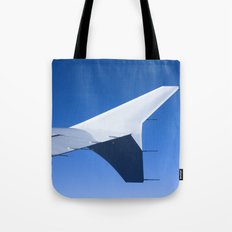 Airplane wing on a blue sky  Tote Bag