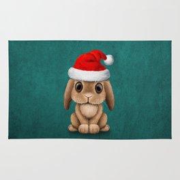 Cute Floppy Eared Baby Bunny Wearing a Santa Hat Blue Rug