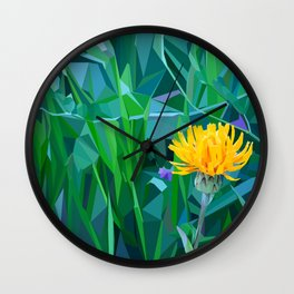 Yellow flower in the grass Wall Clock