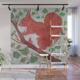 Red squirel on a hazel tree branch Wall Mural