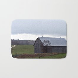 Barn and the Cattle on the hill Bath Mat