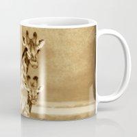giraffes Mugs featuring Giraffes by haroulita