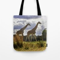 giraffes Tote Bags featuring Giraffes by Photography by Terrance