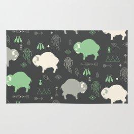Seamless pattern with cute baby buffaloes and native American symbols, dark gray Rug