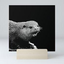 fish otter on a rock vector art black white Mini Art Print