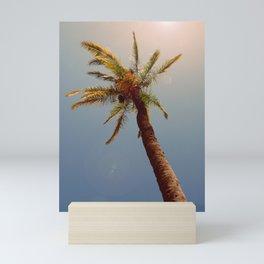 Palm tree under the sun Mini Art Print