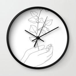 Minimal Hand Holding the Branch II Wall Clock