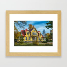 Picture of red wooden scandinavian style house at the lake during autumn Framed Art Print